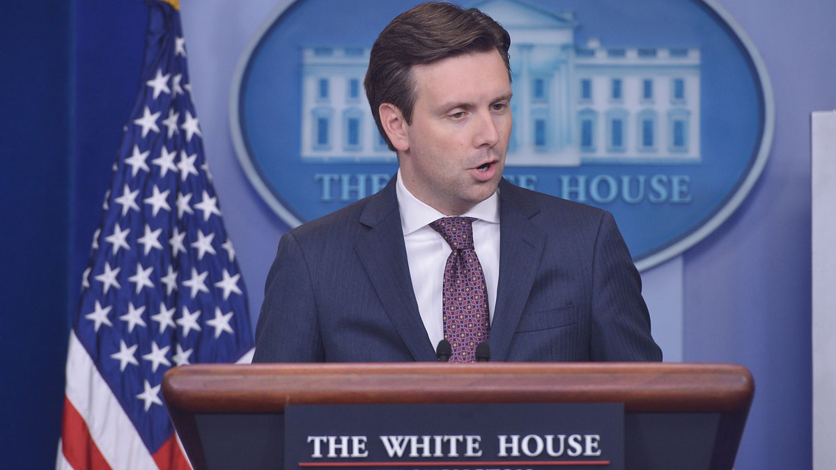 File photo: White House Press Secretary Josh Earnest answers questions on the massive cyber-attack on the personal data of government employees June 5, 2015 during the daily briefing in the Brady Briefing Room of the White House in Washington, D.C.