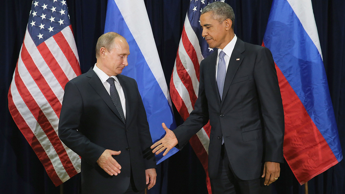 In this Sept. 28, 2015, photo, Russian President Vladimir Putin and U.S. President Barack Obama shake hands for the cameras before the start of a bilateral meeting at the United Nations headquarters in New York City.