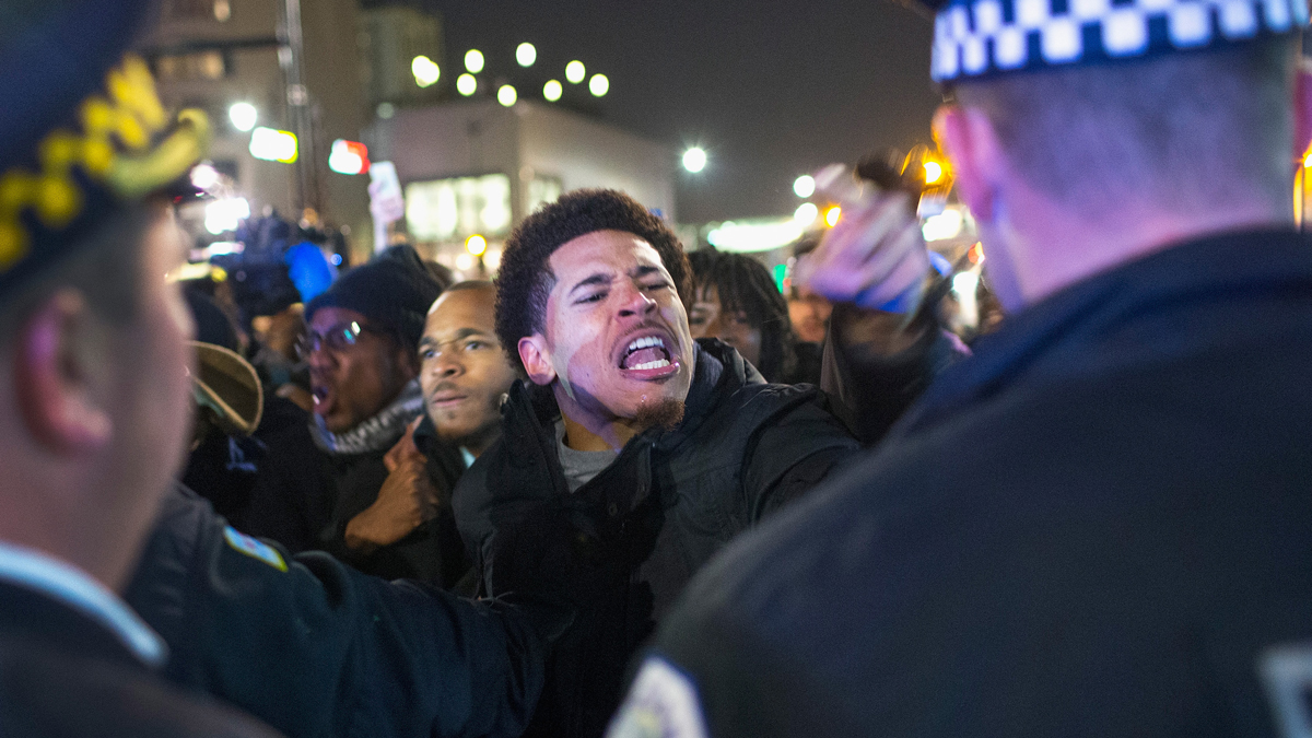 Demonstrators confront police during a protest on November 24, 2015, in Chicago, after the release of video showing the shooting death of Laquan McDonald.