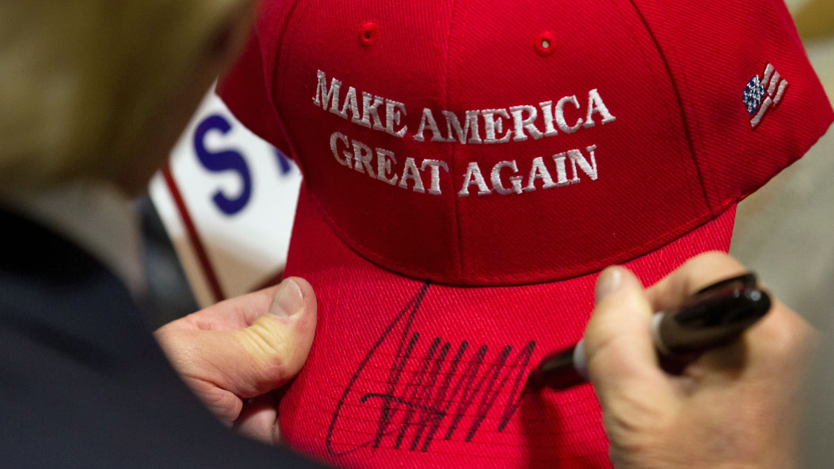 Republican presidential candidate Donald Trump signs a hat after speaking at a rally at the Connecticut Convention Center on April 15, 2016 in Hartford, Connecticut. (Photo by Matthew Cavanaugh/Getty Images)