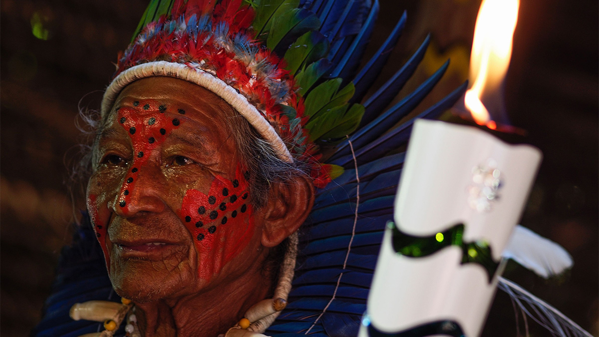 Dessana indigenous shaman Raimundo Dessana carries the Olympic Torch at the Tupe Reservation in the outskirts of Manaus, Amazonas, Brazil, on June 20, 2016.
