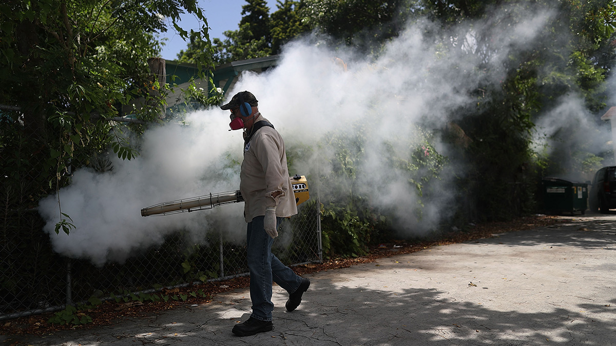 Carlos Varas, a Miami-Dade County mosquito control inspector, uses a Golden Eagle blower to spray pesticide to kill mosquitos in the Wynwood neighborhood of Miami as the county fights to control the Zika virus outbreak on August 2, 2016.