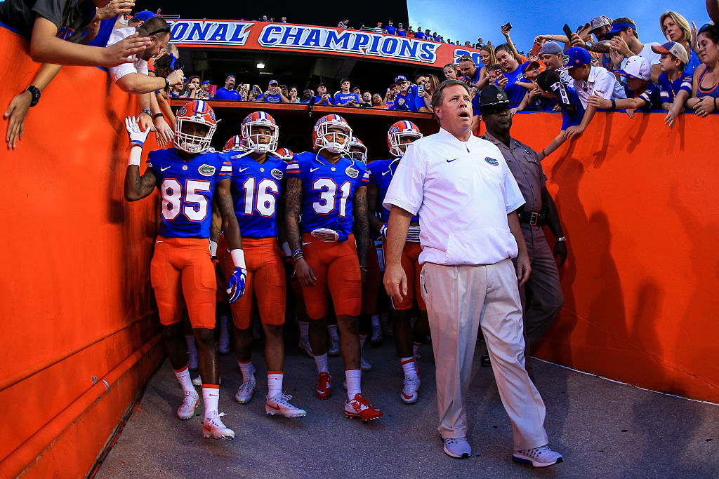 Head coach Jim McElwain leads the Florida Gators onto the field before the game against the North Texas Mean Green at Ben Hill Griffin Stadium on September 17, 2016. in Gainesville, Florida. The Gators' game against LSU has been postponed because of Hurricane Matthew.