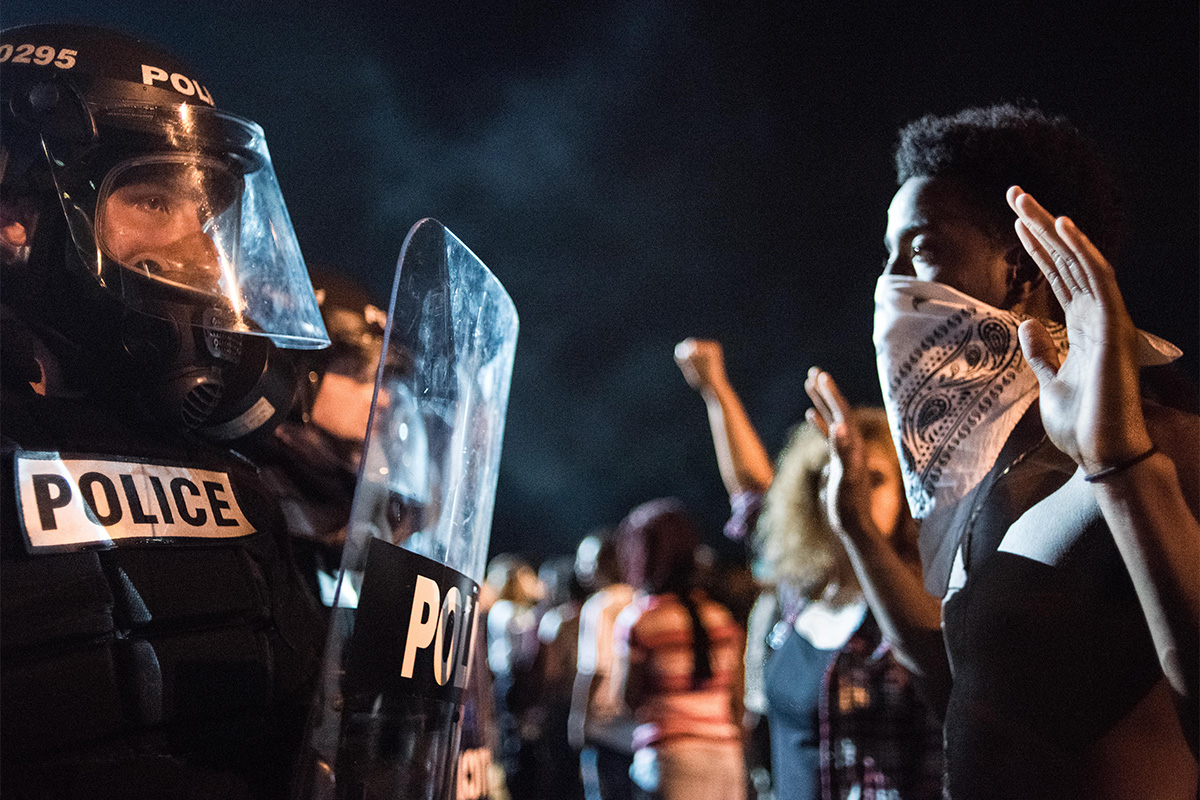Police officers face off with protestors on the I-85 (Interstate 85) during protests following the death of a man shot by a police officer on Sept. 21, 2016, in Charlotte, North Carolina. The protests began the previous night following the fatal shooting of 43-year-old Keith Lamont Scott at an apartment complex near UNC Charlotte.