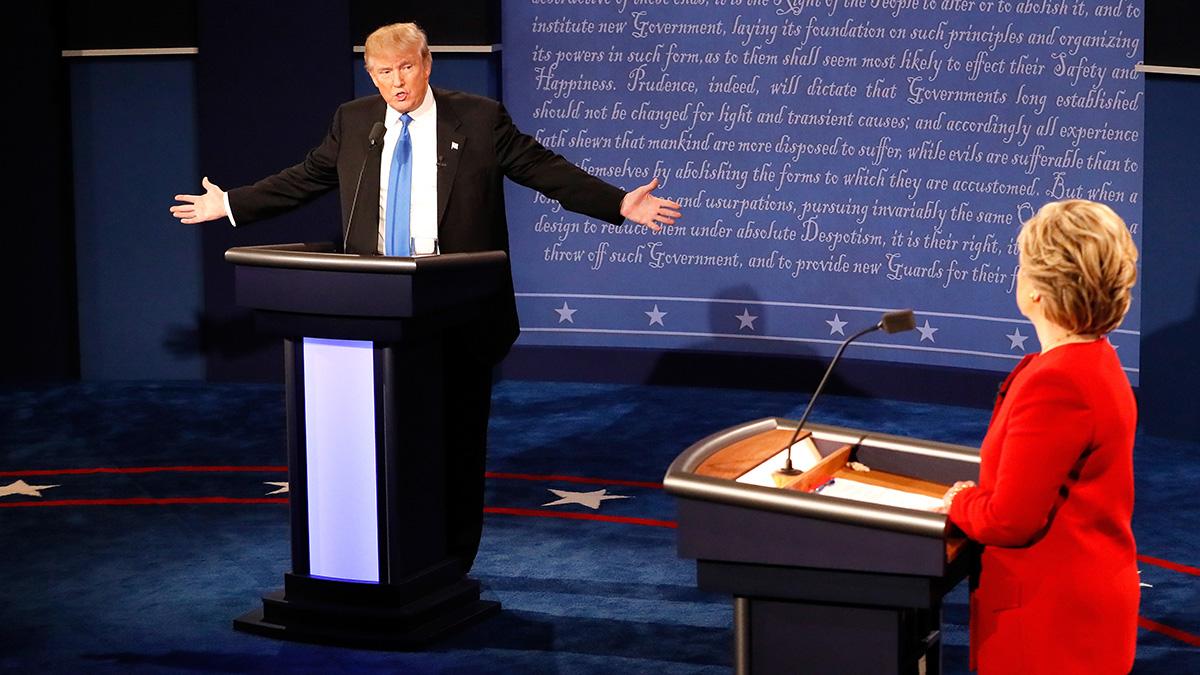 Republican presidential nominee Donald Trump speaks as Democratic presidential nominee Hillary Clinton listens during the presidential debate at Hofstra University on September 26, 2016, in Hempstead, New York.
