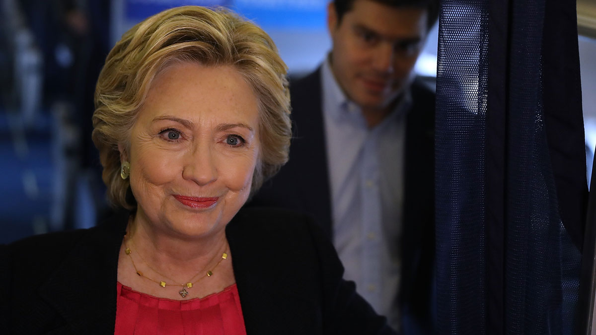 Democratic presidential nominee Hillary Clinton speaks to reporters aboard her campaign plane before departing from Westchester County Airport on Sept. 27, 2016, in White Plains, New York. Hillary Clinton is campaigning in North Carolina a day after facing off with Republican presidential nominee Donald Trump in the first presidential debate.