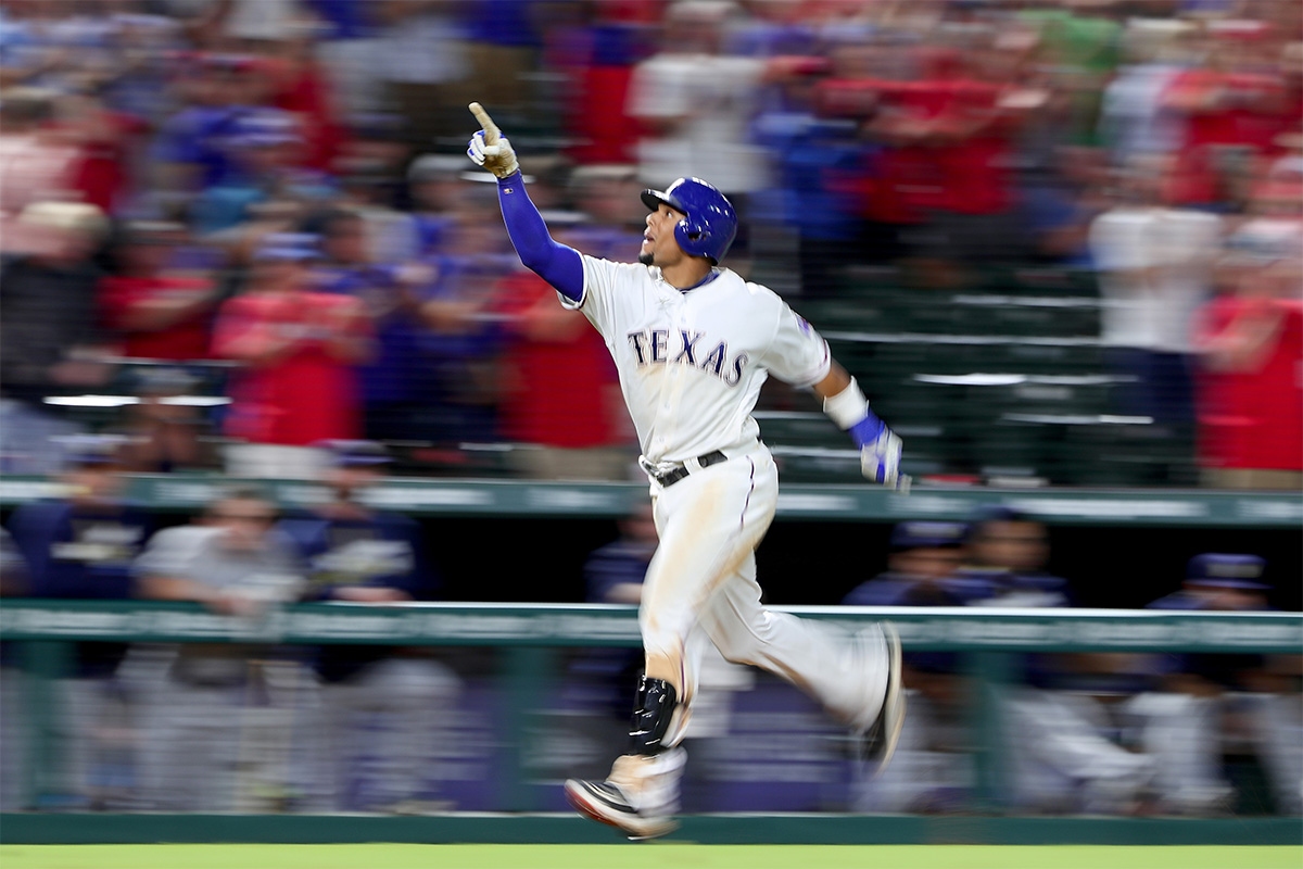 Carlos Gomez #14 of the Texas Rangers celebrates after hitting a three run home run off of Tyler Thornburg #37 of the Milwaukee Brewers in the bottom of the eighth inning to beat the Brewers 8-5 at Globe Life Park in Arlington on Sept. 28, 2016, in Arlington, Texas.