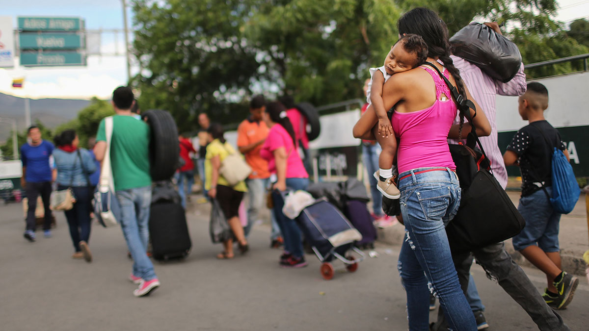 People carry goods purchased in Colombia on their way to cross the international border bridge back to Venezuela on Oct. 4, 2016, in Cucuta, Colombia. The dire economic crisis in Venezuela sends thousands of Venezuelans daily across the international border bridge to Cucuta, Colombia, to purchase food, medicine and other desperately needed supplies. U.N. Secretary General Ban Ki-moon has called the situation in Venezuela a 'humanitarian crisis'.