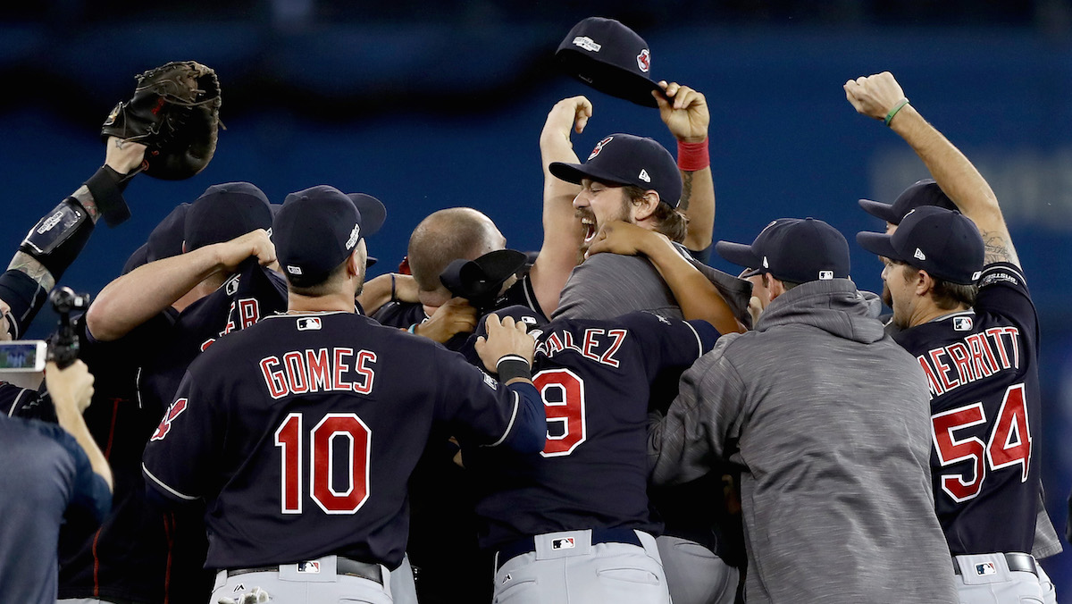 Andrew Miller #24 of the Cleveland Indians celebrates with his teammates after defeating the Toronto Blue Jays with a score of 3 to 0 in game five of the American League Championship Series at Rogers Centre on October 19, 2016 in Toronto, Canada.