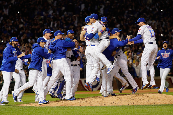 The Chicago Cubs celebrate defeating the Los Angeles Dodgers 5-0 in game six of the National League Championship Series to advance to the World Series against the Cleveland Indians at Wrigley Field on October 22, 2016 in Chicago, Illinois. (Photo by Jamie Squire/Getty Images)