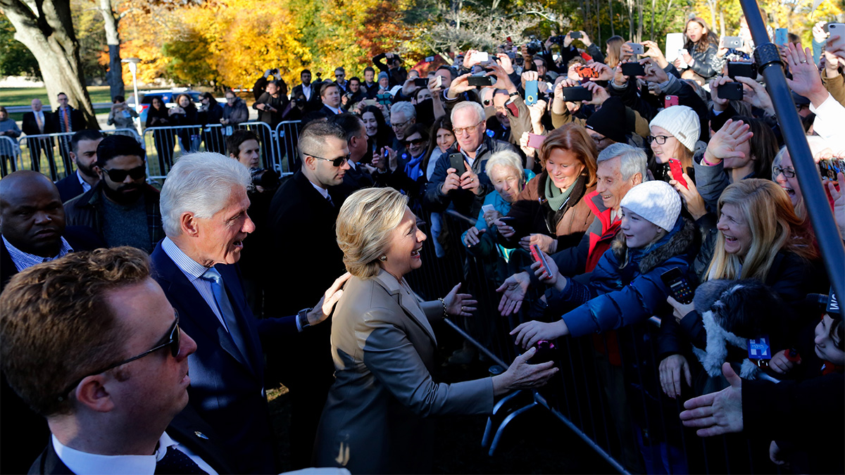 Hillary Clinton and her husband Bill greet supporters after casting her vote in Chappaqua, New York on Nov. 8, 2016. After an exhausting, wild, bitter, and sometimes sordid campaign, Americans finally began voting Tuesday for a new president: either the billionaire populist Donald Trump or Hillary Clinton, seeking to become the first woman to win the White House.