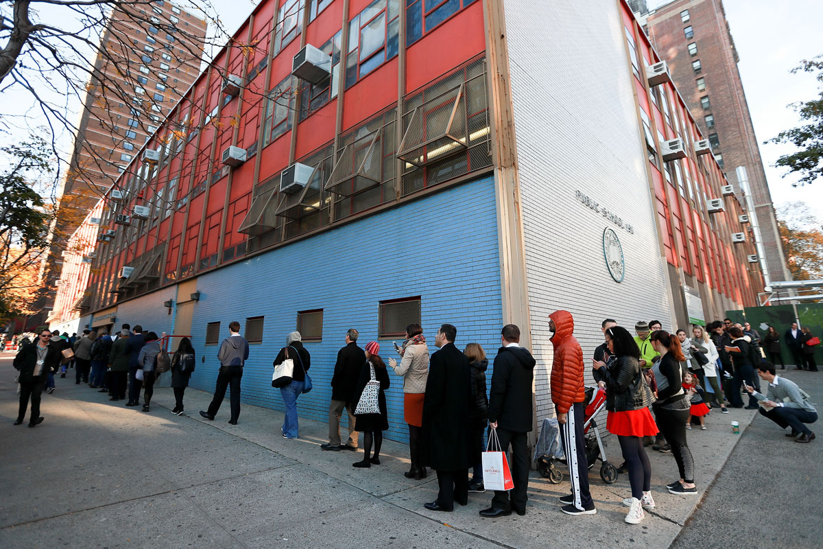 NEW YORK, NY - NOVEMBER 08:  Lines of voters wrap around the outside of PS198M The Straus School as they wait to cast their ballots on November 8, 2016 in New York City, New York. Americans across the nation are picking their choice for the next president of the United States.  (Photo by Michael Reaves/Getty Images)
