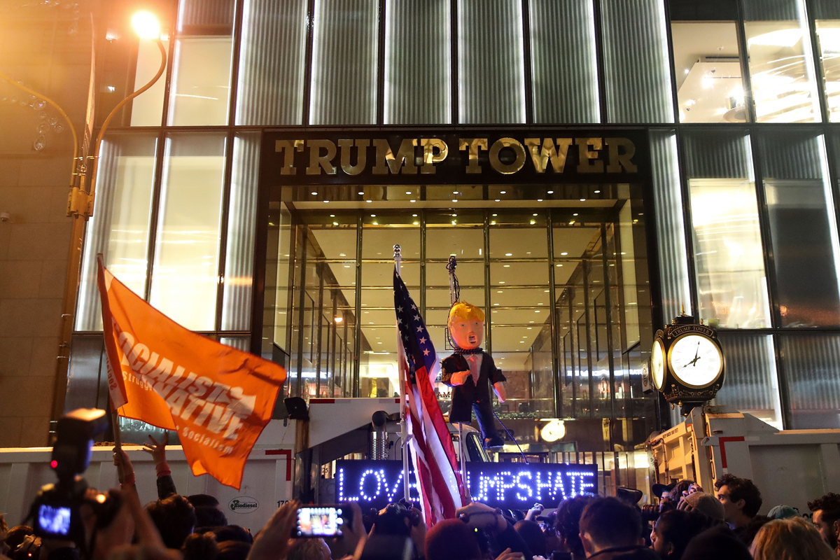 File photo: Hundreds of protestors rallying against Donald Trump gather outside of Trump Tower, Nov. 9, 2016, in New York City.