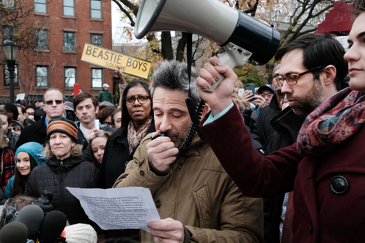 Beastie Boys member Adam Horovitz speaks at a anti-hate rally at a Brooklyn park named in memory of Beastie Boys band member Adam Yauch after it was defaced with swastikas on Nov. 20, 2016, in New York City. On Friday, the park and playground was spray-painted with swastikas and the message