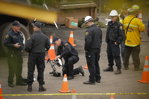 OAKLAND, CA - DECEMBER 05: Law enforcement officers work with a drone equipped with a thermal imaging camera at the site of a warehouse fire that has claimed the lives of at least thirty-six people on December 5, 2016 in Oakland, California. The fire took place during a musical event late Friday night. (Photo by Elijah Nouvelage/Getty Images)