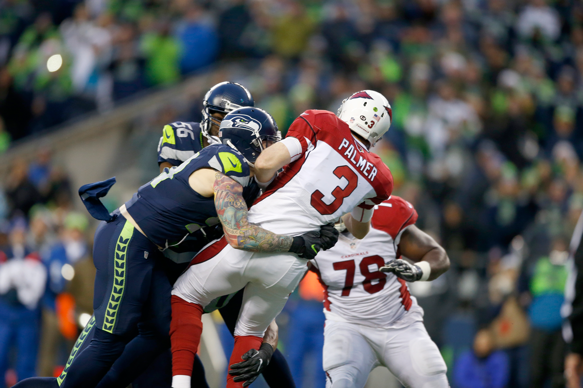 Quarterback Carson Palmer #3 of the Arizona Cardinals is brought down by the Seattle Seahawks at CenturyLink Field on Dec. 24, 2016, in Seattle, Washington. The Cardinals won 34-31.