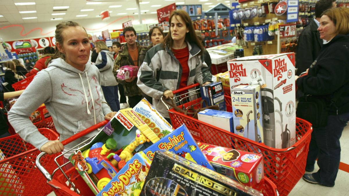 Shoppers load up their shopping baskets at Target on Black Friday in Hobart, Indiana.