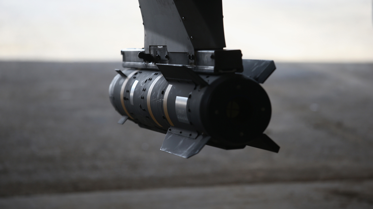 In this Jan. 7, 2016, file photo, a Hellfire missile hangs from a U.S. Air Force MQ-1B Predator unmanned aerial vehicle (UAV), at a secret air base in the Persian Gulf region.