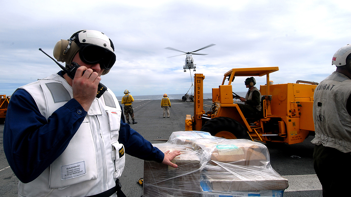 Lt. Gentry Debord gives a report during a vertical replenishment aboard the amphibious assault ship USS Essex with the Military Sealift Command combat stores ship USNS Niagara Falls. Taken in the South China Sea on Feb. 29, 2008.