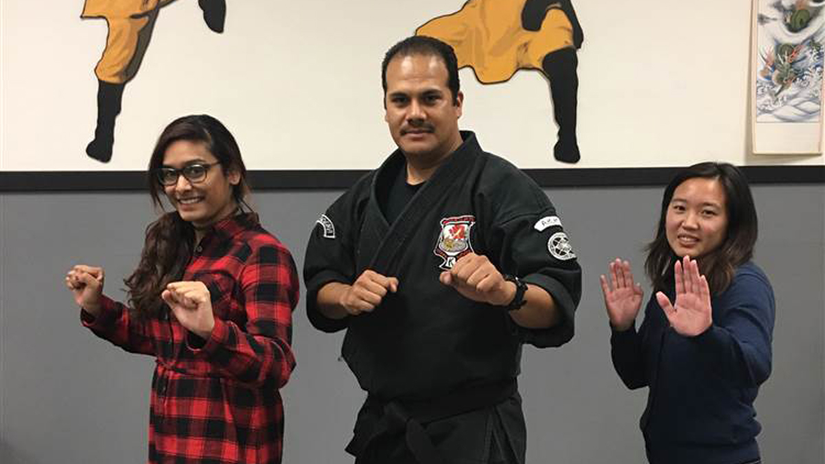 LAPD officer Maurice Gomez (center) at a women's self-defense class he teaches in Duarte, California.