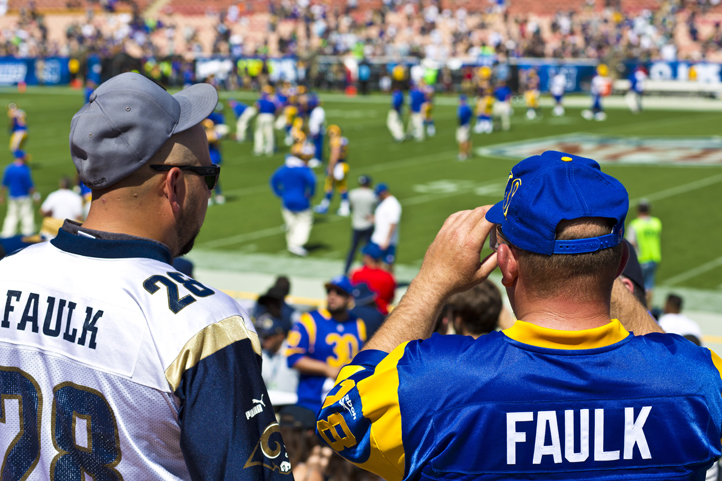 LA Rams fans stand side-by-side in a jersey featuring the St. Louis colors and the Los Angeles colors
