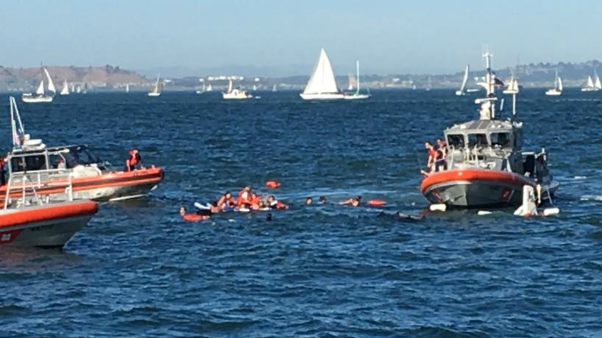 Rescue crews work to pluck people from the San Francisco Bay after a boat capsized (Oct. 8, 2016).