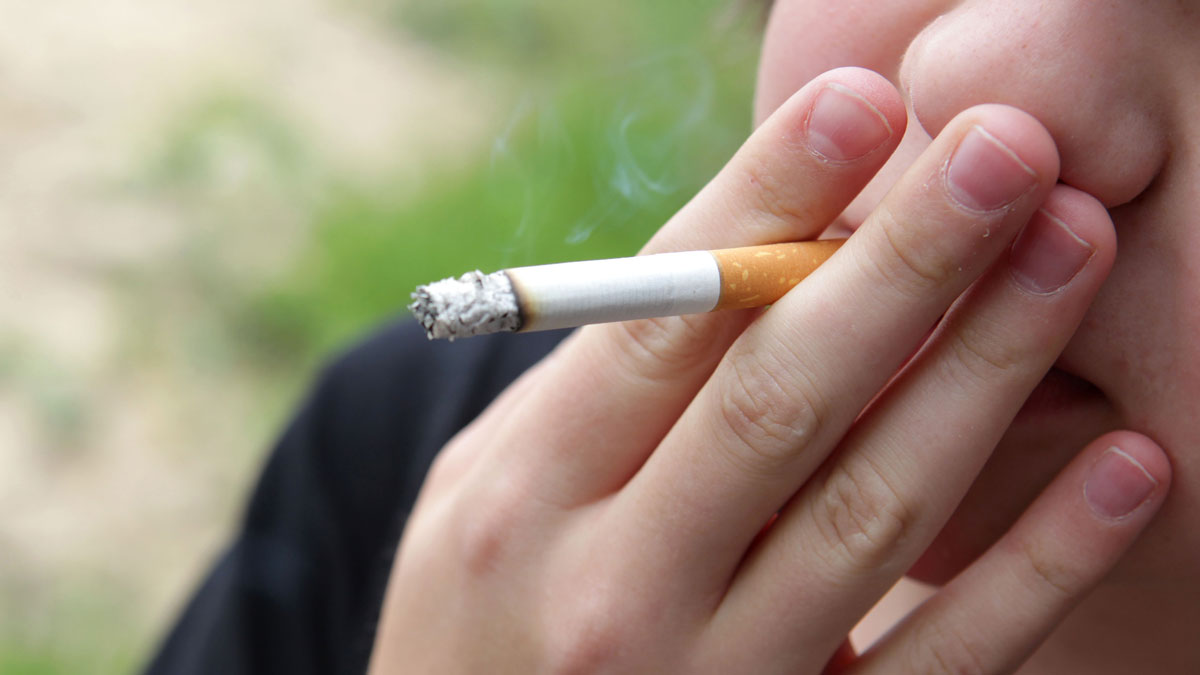 A teen smokes a cigarette in this file photo.