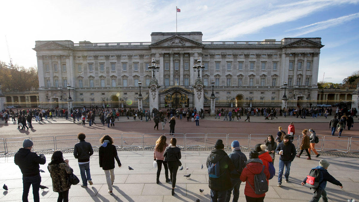 People take pictures in front of Buckingham Palace which is due for a significant taxpayer-funded renovation, London, Friday Nov. 18, 2016.