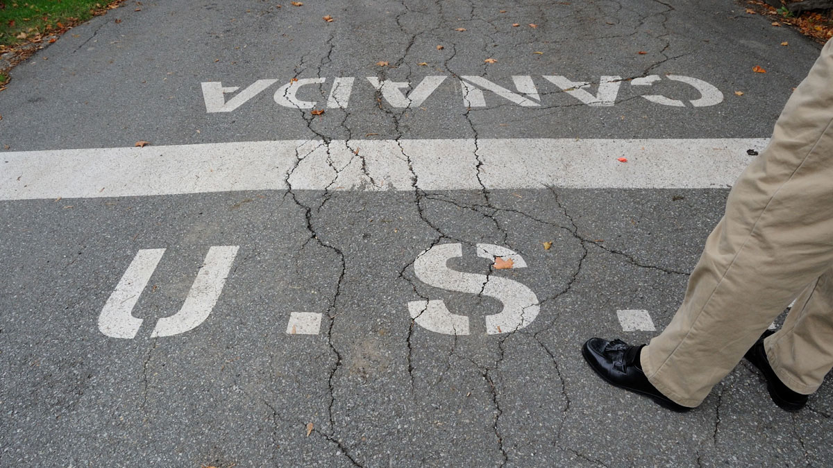 A person is shown standing near the U.S.-Canadian border in Derby Line, Vt., on Friday, Oct. 2, 2009.