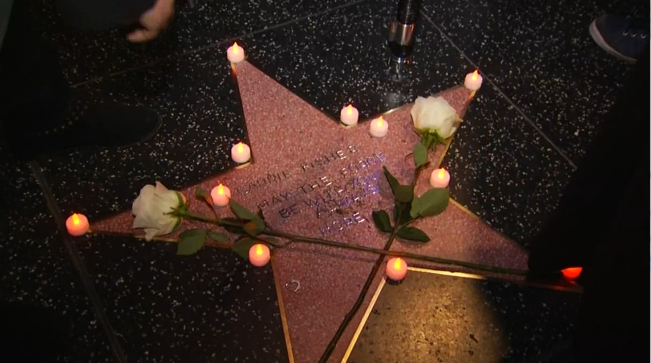 Fans honored Carrie Fisher's legacy by crafting her own star on the Hollywood Walk of Fame on Tuesday, Dec. 27, 2016.