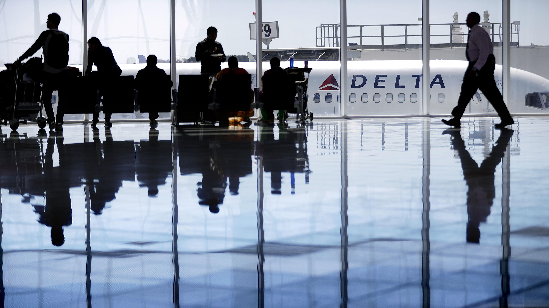 File photo - A Delta Air Lines jet sits at a gate at Hartsfield-Jackson Atlanta International Airport, in Atlanta, Thursday, Oct. 13, 2016.