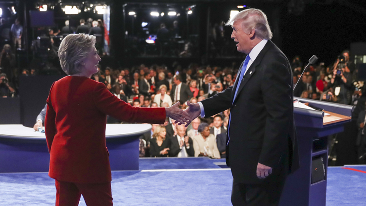 Presidential nominees Hillary Clinton and Donald Trump shake hands after the opening presidential debate at Hofstra University in Hempstead, New York, Sept. 26, 2016.