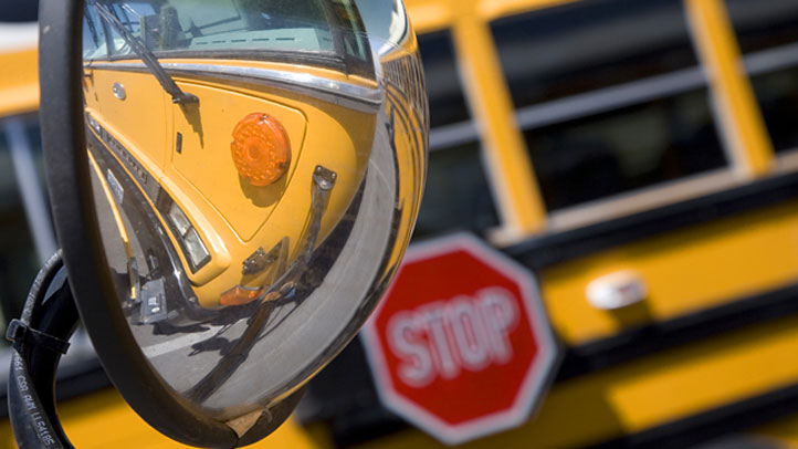 A child is dead after being dragged, then hit, by a school bus in Massachusetts Friday.