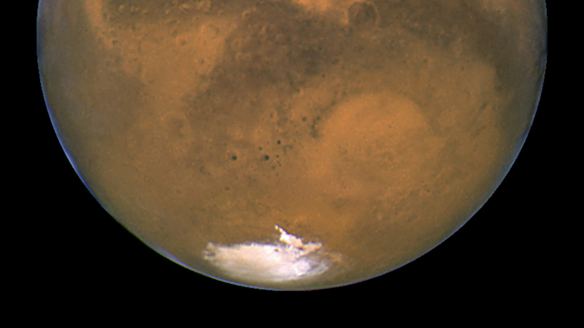 This Aug. 26, 2003 image made available by NASA shows Mars as it lines up with the Sun and the Earth. Photographed by the Hubble Space Telescope, it was about 55.8 million kilometers (34.6 million miles) from Earth.