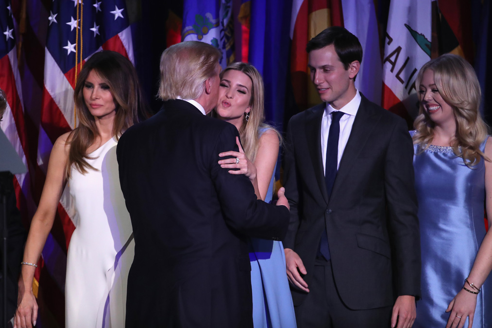 Republican president-elect Donald Trump and his daughter Ivanka Trump embrace as his wife Melania Trump (L), Jared Kushner (2nd-R) ad Tiffany Trump look on after delivering his acceptance speech at the New York Hilton Midtown in the early morning hours of November 9, 2016 in New York City.