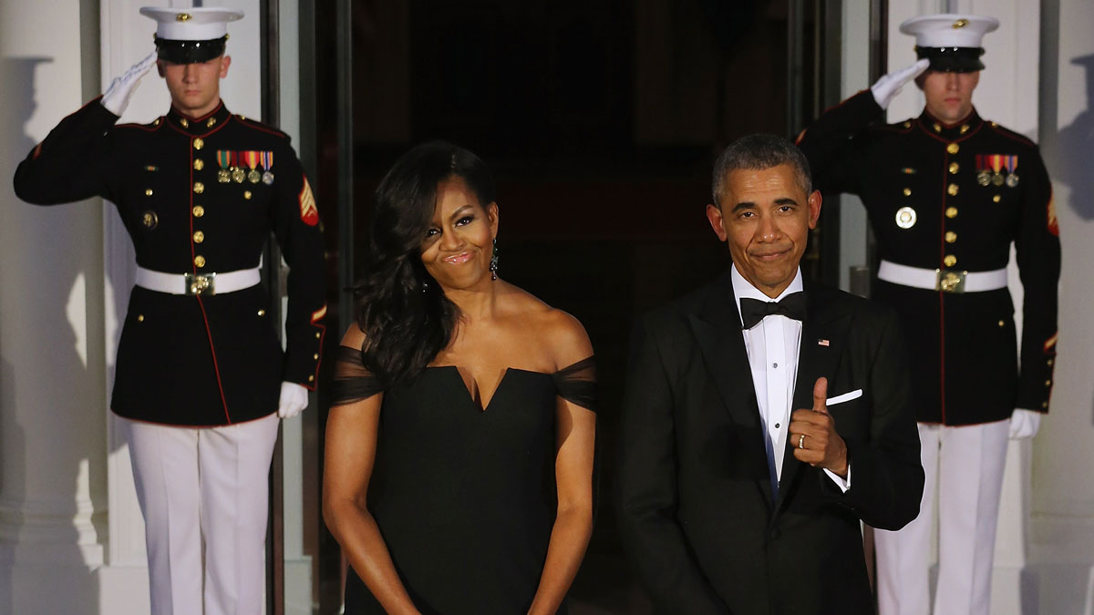 Stock Photo -- U.S. President Barack Obama gives the thumbs-up when talking about how U.S. First Lady Michelle Obama looks while waiting on the North Portico for the arrival of Chinese President Xi Jinping and his wife Madame Peng Liyuan ahead of a state dinner at the White House September 25, 2015 in Washington, DC.