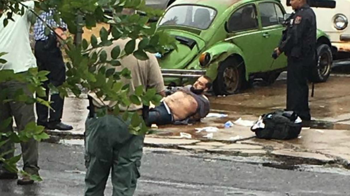 Ahmad Rahami is taken into custody after a shootout with police in Linden, New Jersey. (Credit: Moshe Weiss)