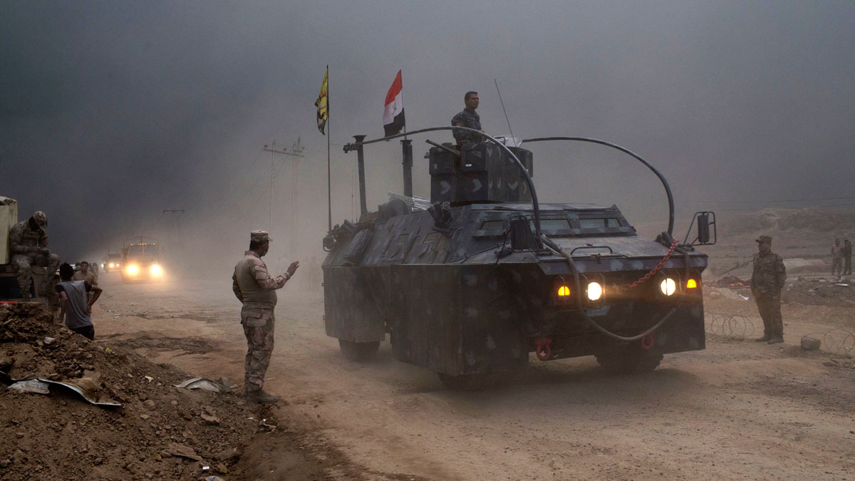 An Iraqi Federal Police vehicle passes through a checkpoint in Qayara, some 31 miles south of Mosul, Iraq, Wednesday, Oct. 26, 2016.