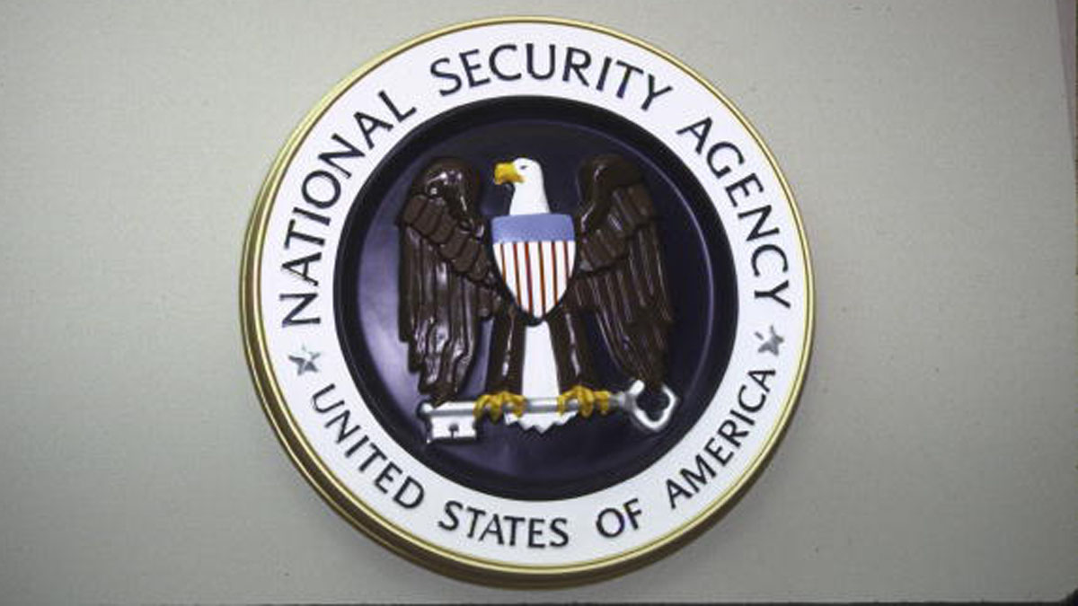National Security Agency seal hanging on wall.