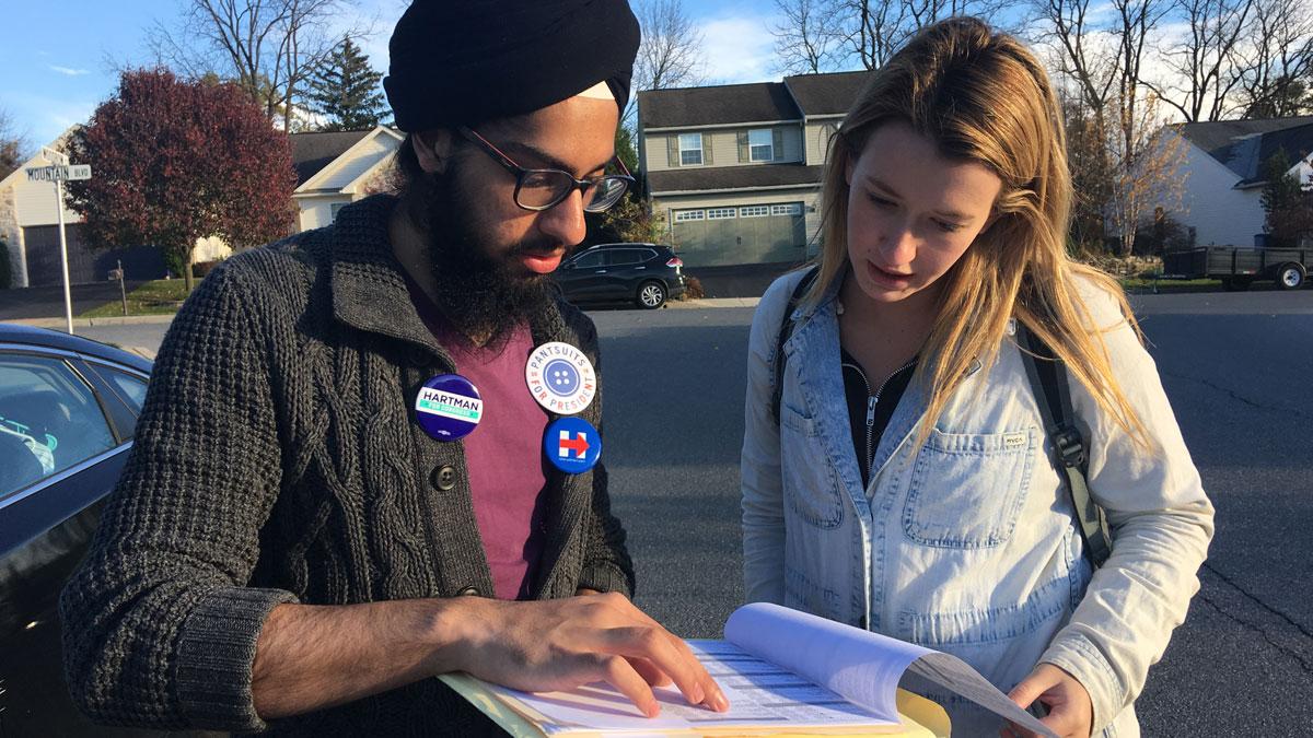 Columbia students Gurnoor Tucker and Ellie Lipe canvas around suburban Reading on Nov. 6, 2016.