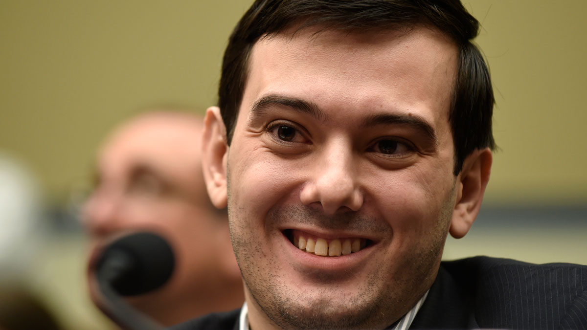Pharmaceutical chief Martin Shkreli smiles on Capitol Hill in Washington, Thursday, Feb. 4, 2016, during the House Committee on Oversight and Reform Committee hearing on his former company's decision to raise the price of a lifesaving medicine. Shkreli refused to testify before U.S. lawmakers who excoriated him over severe hikes for a drug sold by a company that he acquired.
