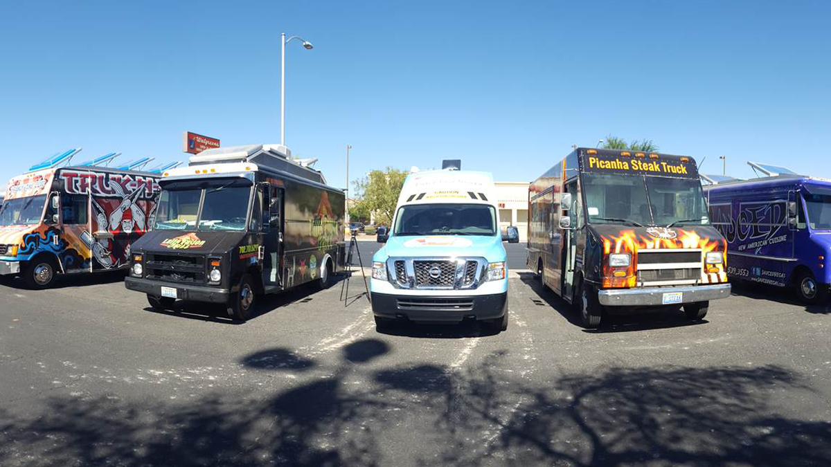 Photo of taco trucks parked in Las Vegas, drawing in potential eligible voters to register people to vote on Tuesday, October 18, 2016. More trucks are set to form a