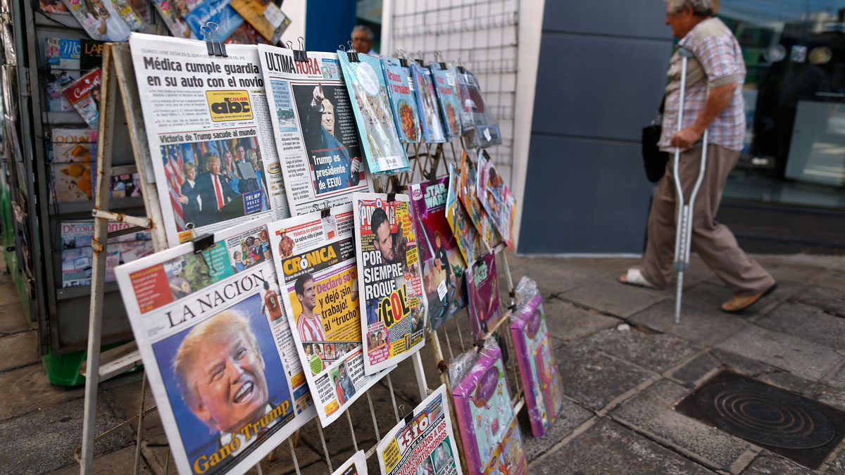 Paraguay's newspaper covers are on display at a kiosk with headlines reading in Spanish