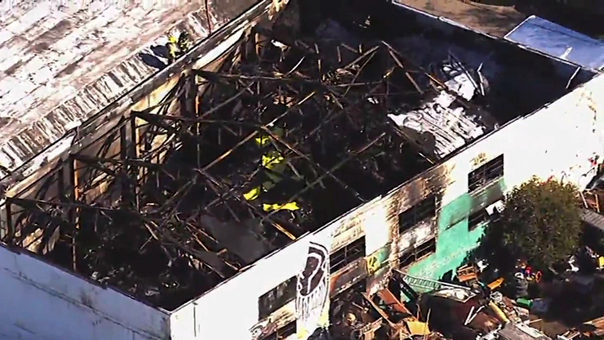 Aerial footage of the badly damaged Oakland warehouse. (Dec. 3, 2016)