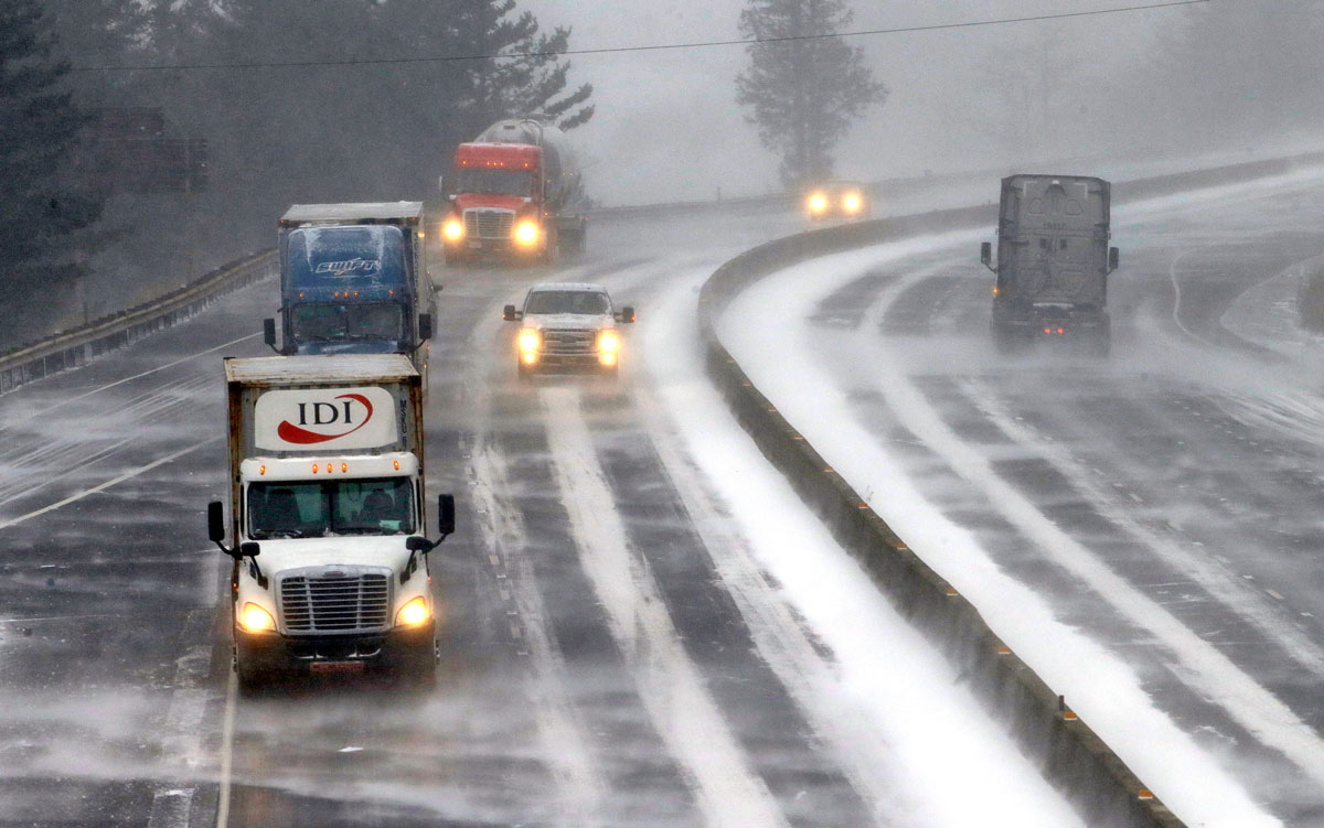 Traffic on Interstate 84 navigate over ice, packed snow and against heavy winds in the Columbia River Gorge near Bridal Veil, Ore., Thursday, Dec. 8, 2016, as the first winter storm of the season hits the region.